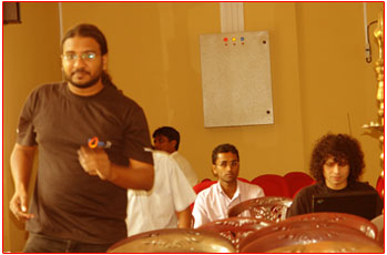 Suchetha from FOSS doing a lesson