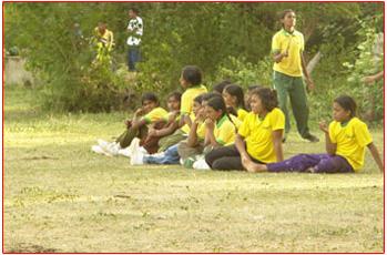 Girls cheering the players