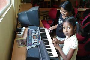 Kids practicing electric organ