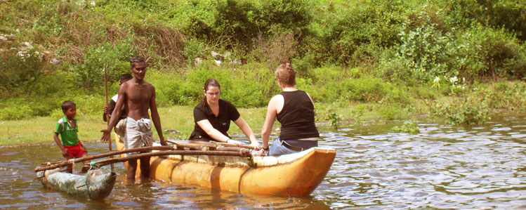 Lindy and Lien in a canoe in Mahawilachchiya reservoir
