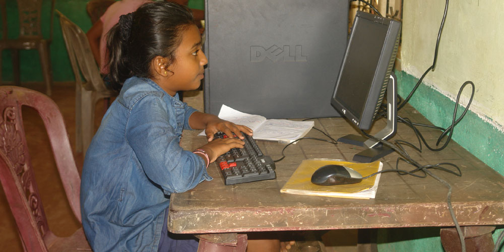 Nimanditha practicing a computer donated by LOLC