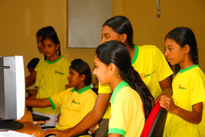 Happy junior students with brand new PCs from Dialog.