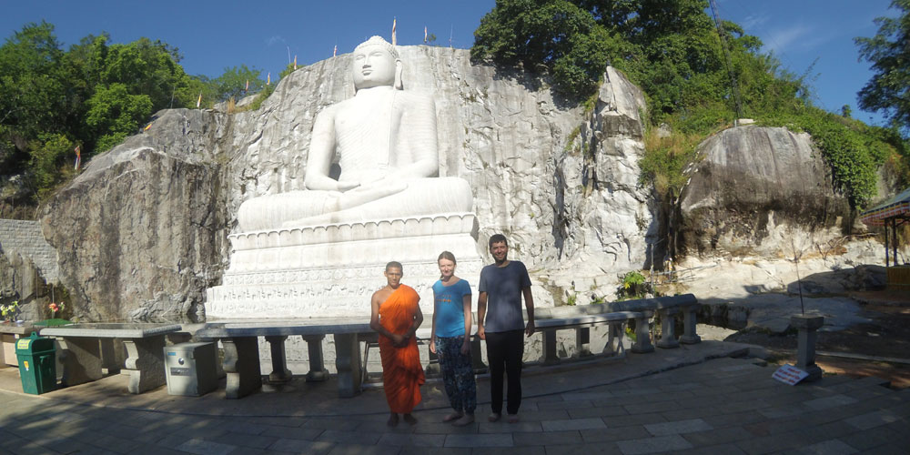 Klára Gebhartová and Lubosh at a Buddh statue