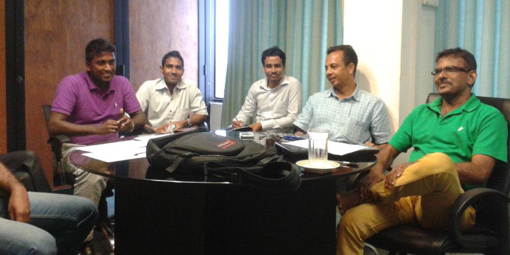 LankCom staff with Mr. Wanni at LankaCom's meeting room.