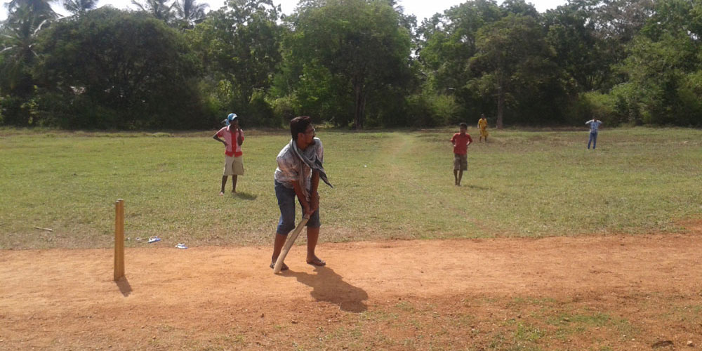 Ejaz Bhatia of CPI/Eckova playing cricket with the children