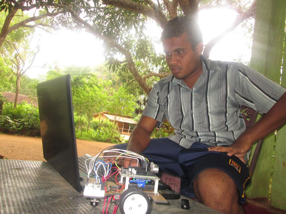 Dhananjaya Wijewickrama setting up the Pi-Bot robot unit