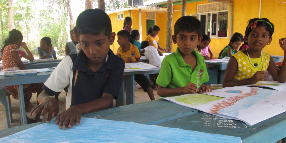 Children busy with drawing