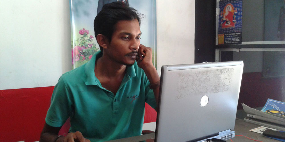 Nuwan Sampath Dissanayaka, with one of the laptops from Rehan