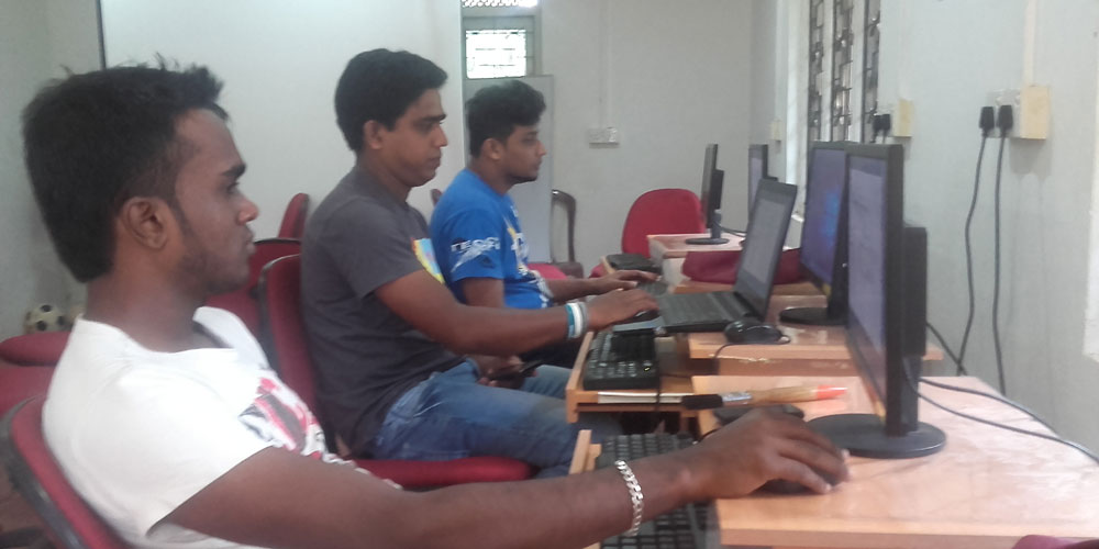 DiGiTECH COMPUTERS team installing new software at Horizon Lanka