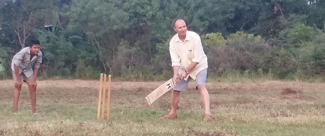 Dmitri Smirnoff playing cricket in the village playground
