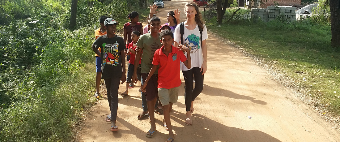 Emilie Demellayer walking with Horizon Lanka students