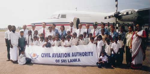 Veddah Children with the officials of Civil Aviation Authority of Sri Lanka