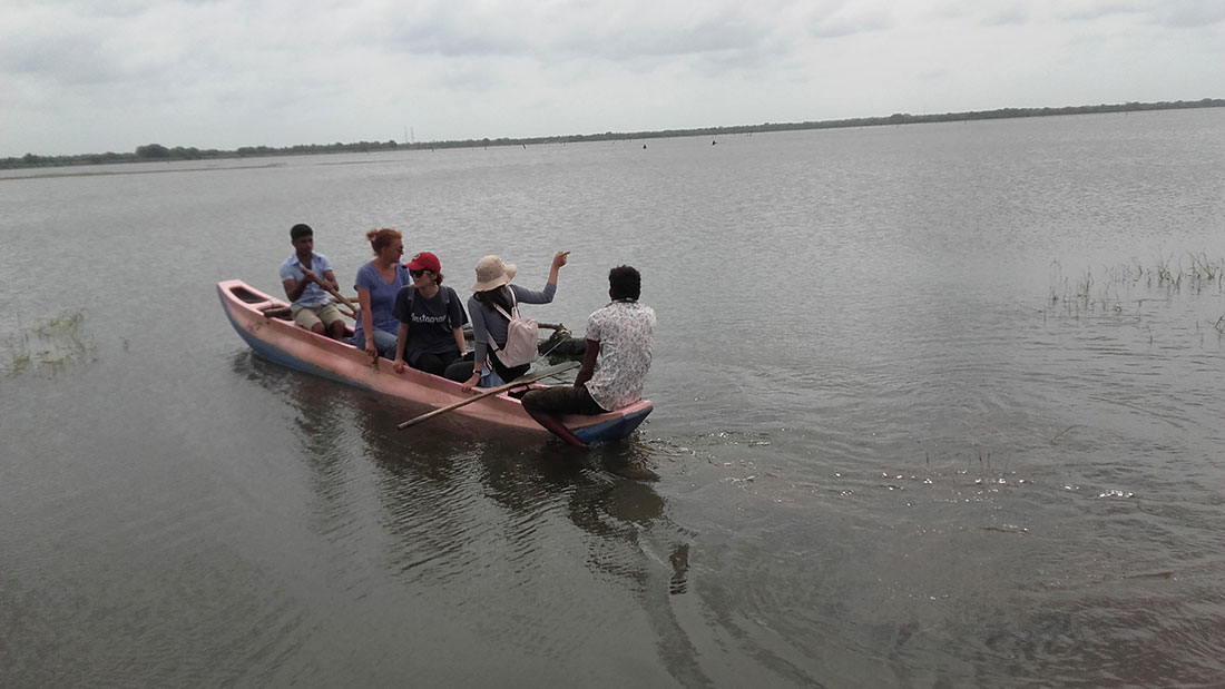 Rowing a canoe in Mahawilachchiya reservoir
