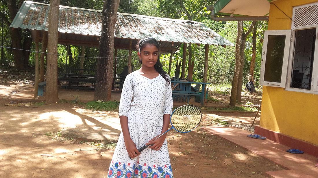 Pramodhya Umayangani with a badminton racket