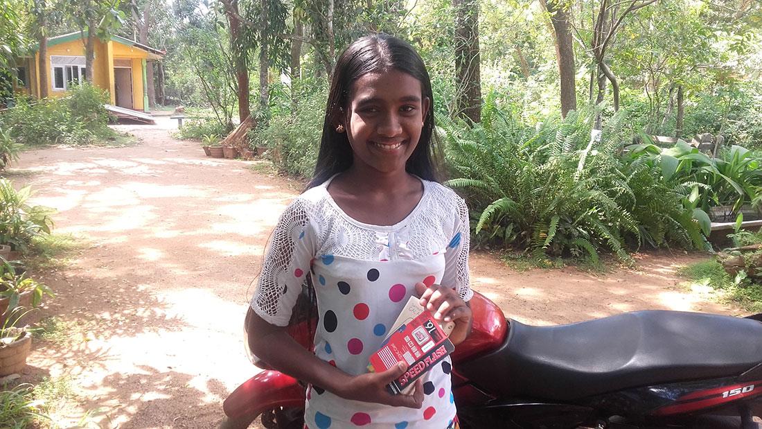 Tharani Madhara Rathnayaka with her phone