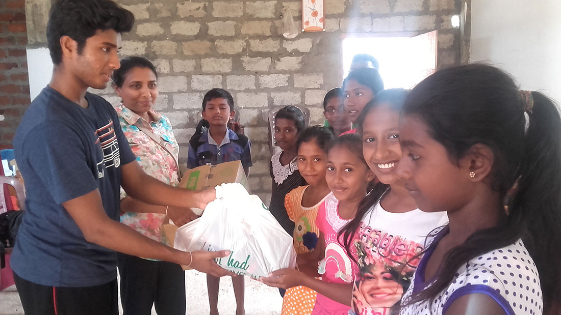 Ms. Champika and Thimira donating school supplies to the students of Horizon Academy, Tantirimale