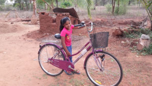 Himaya Anjali with her new bicycle