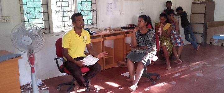 Parents, staff and students meeting at Horizon Lanka Academy, Mahawilachchiya