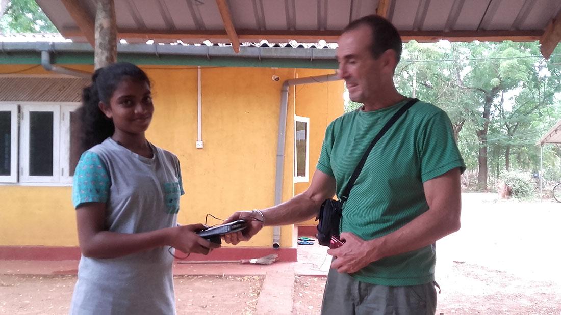 Pramodhya Umayangani getting a tab from Mr. Qurro Lopez as a gift.