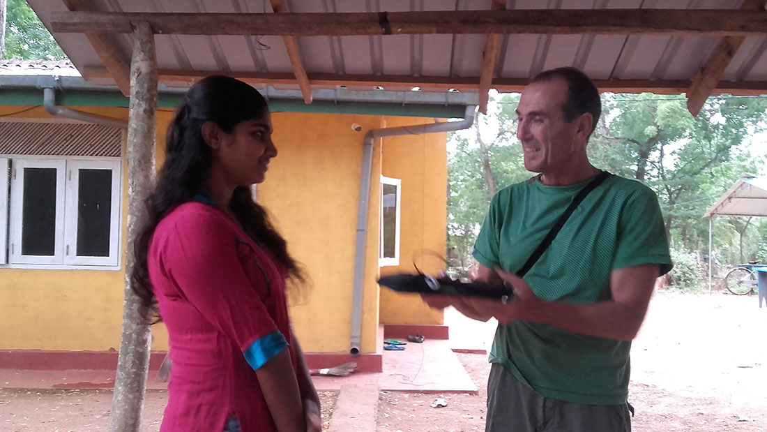 Tharushika Sujani Rathnayaka getting a Samsung tab from Mr. Qurro Lopez Torres