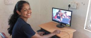 Nadeeka Kumarasingha with a computer at Horizon Academy - Mahawilachchiya.