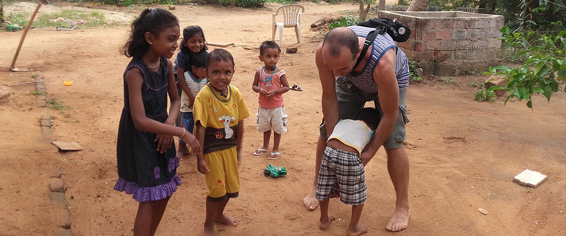 Quro Lopez with the kids in Mahawilachchiya