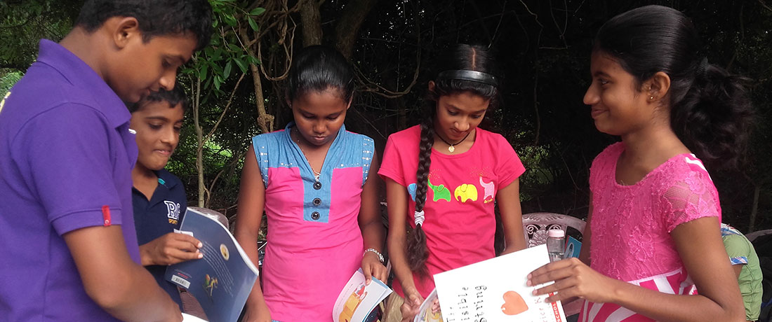 Kids reading books received from Room to Read, Sri Lanka.
