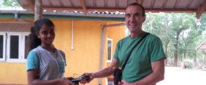 Qurro Lopez donating a used tab to student Pramodhya Gunarathna