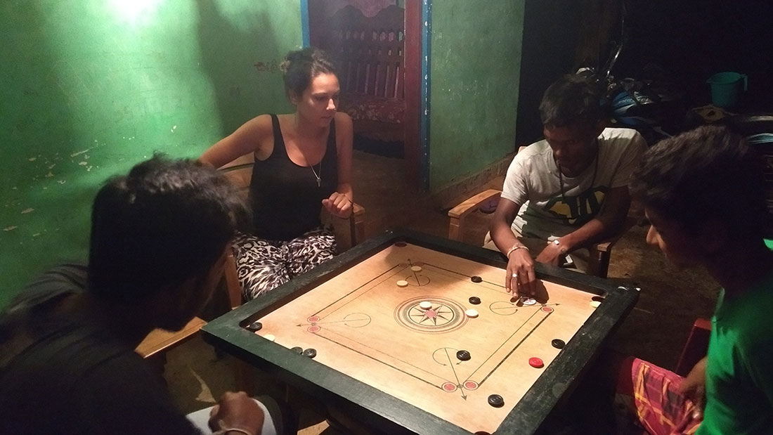 Clara Lopez playing carrom at her host's house in Tantirimale