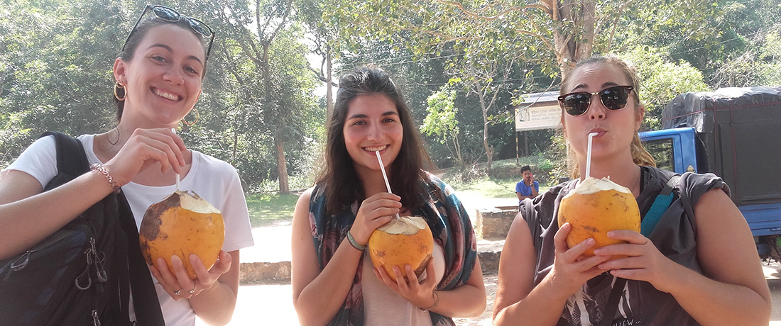 Clara Charrière drinkin king coconuts in Kalawewa