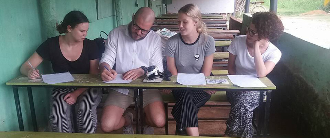 Teresa Fürst interviewing students with other volunteers