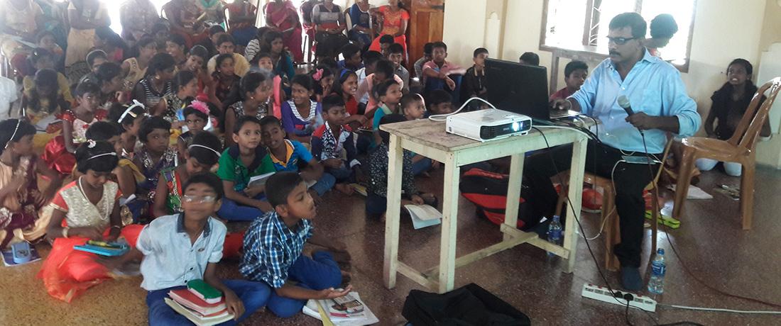 Mr. Nanda Wanninayaka doing the presentation while Father Sebastian translating it into Tamil