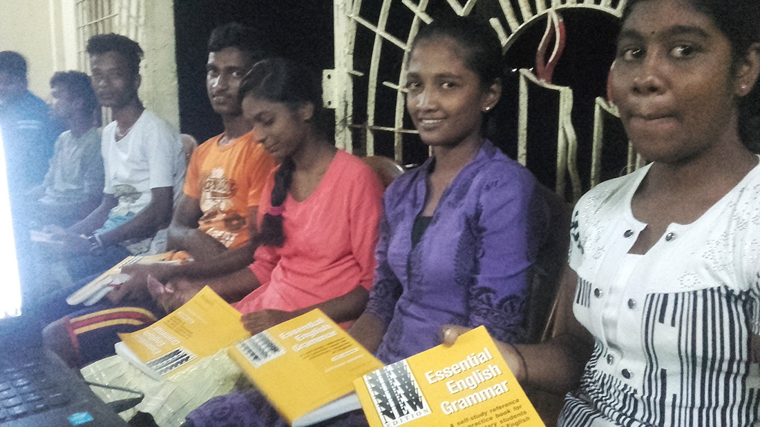 "Happy 12th graders of Horizon Academy - Maniyanthoddam, Jaffna Sri Lanka with the ""Essential English Grammar"" book by Raymond Murphy."