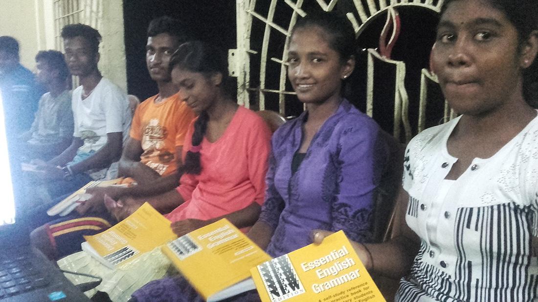 "Happy 12th graders of Horizon Academy - Maniyanthoddam, Jaffna Sri Lanka with the ""Essential English Grammar"" book by Raymond Murphy."
