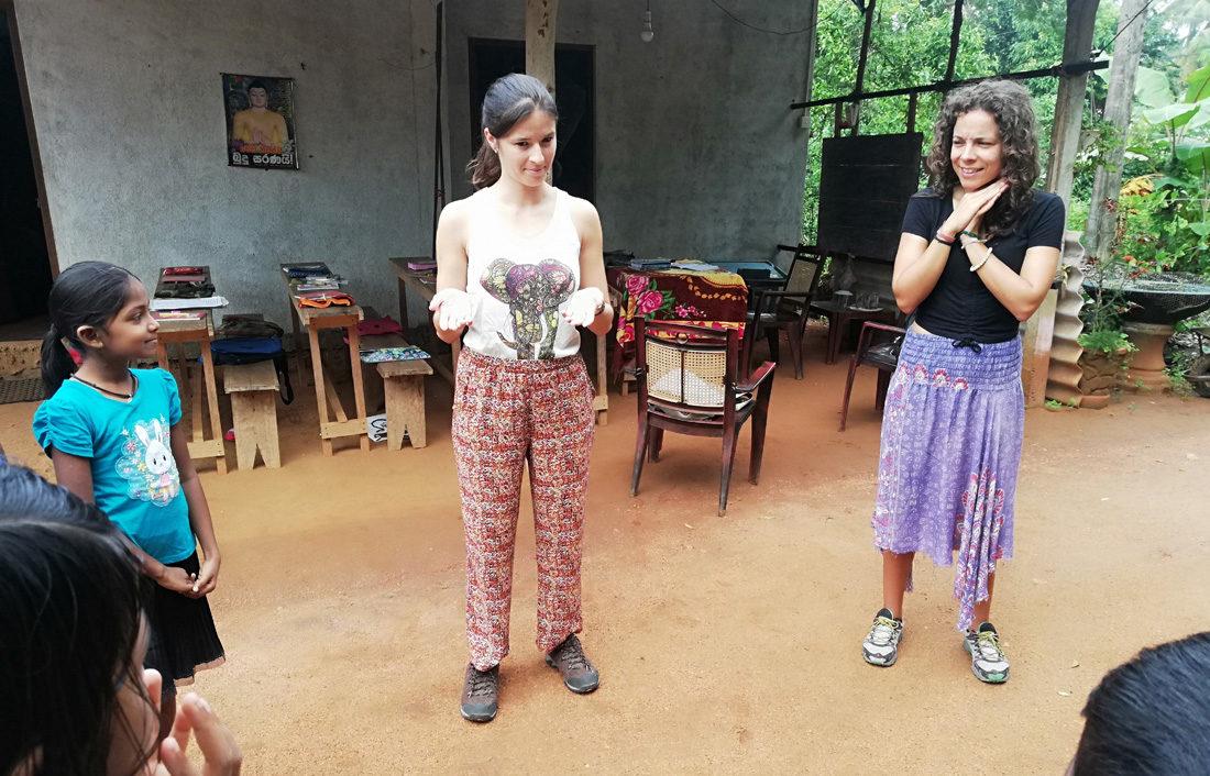 Vanessa Goncalves and Ana Rita Silva interacting with the kids